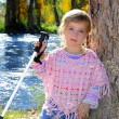 Blond little girl outdoor park excursion cane autumn — Stock Photo #5553842