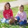 Stock Photo: Two little girls sister friends golden retriever puppy dog