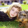 Dog pet and littl girl portrait on garden grass park — Stock Photo