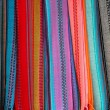 Indian colorful scarf in a row scarves — Stock Photo