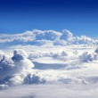 Blue sky high view from airplane clouds — Stock Photo