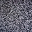 Black and white TV screen noise texture pattern - Stock Photo