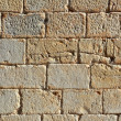 Castle masonry wall carved stone rows pattern texture — Foto de Stock