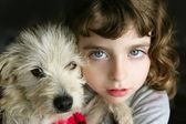 Dog puppy pet and girl hug portrait closeup blue eyes — Stock Photo