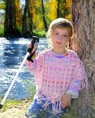 Blond little girl outdoor park excursion cane autumn — Stock Photo