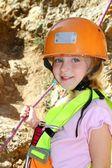 Climbing little girl smiling portrait helmet rope — Stock Photo