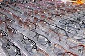 Glasses for close up view in rows many eye glasses — Stock Photo