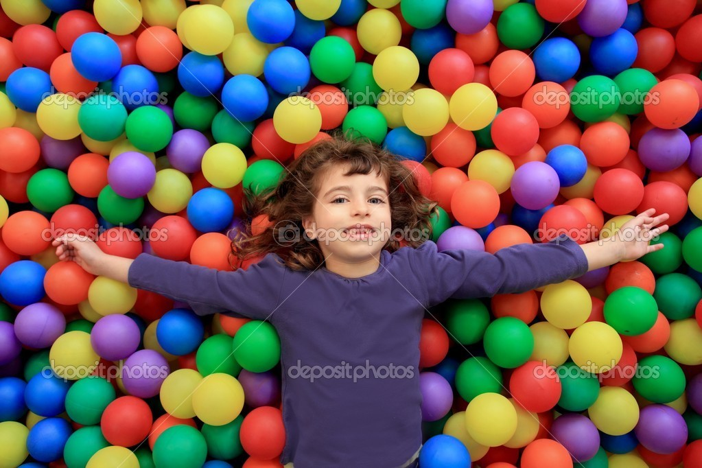 Colorful balls funny park little girl lying gesturing happy — Stock Photo #5554054