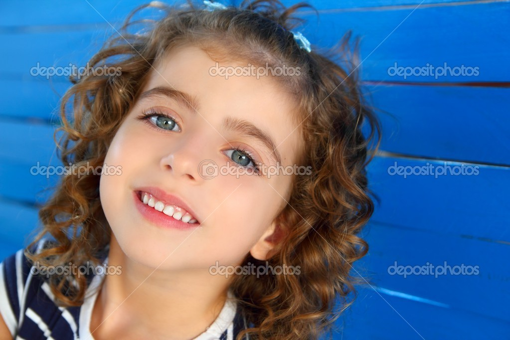 Children little girl smiling portrait on wooden blue wall — Stock Photo #5554213
