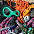 Climbing equipment shackles harnesses ropes - Stock Photo