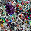 Stock Photo: Colorful jewellery mixed mess in retail market