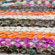 Colorful jewellery necklace rows pink orange - Stock Photo