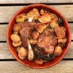 Lamb meat roast oven on clay casserole potatoes — Stock Photo #5567175