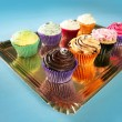Foto Stock: Cupcakes colorful cream muffin arrangement