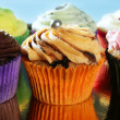 Cupcakes colorful cream muffin arrangement — Stock fotografie #5567484
