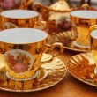 Ancient golden porcelain cups coffe or tea — Stock Photo