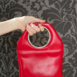 Handbag retro vintage fashion red bag on gray wallpaper - Stock Photo
