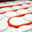 Radiant floor heating tube red pipe curved circle pattern - Stock Photo