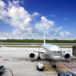 Aircraft airplane plane landed airport blue sky — Stock Photo #5569418