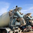Stock Photo: Concrete mixer two trucks rear view grunge