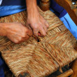 Enea traditional spain reed chair handcraft man hands working - Stock Photo