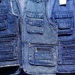 Denim blue jeans vest rows in a retail shop — Stock Photo