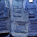 Denim blue jeans vest rows in a retail shop — Stock Photo