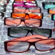 Stock Photo: Glasses for close up view in rows many eye glasses