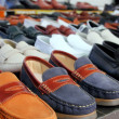 Leather shoes retail shop in rows varied colors — Stock Photo