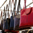 Bags rows in retail shop handbags leather red — Stock Photo