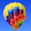 Balloon colorful vivid colors in blue sky — Foto de Stock