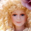 Antique old blond porcelain doll face protrait — Stock Photo #5569837