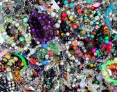 Colorful jewellery mixed mess in a retail market — Stock Photo