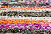 Colorful jewellery necklace rows pink orange — Stock Photo