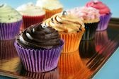 Cupcakes colorful cream muffin arrangement — Stok fotoğraf
