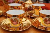 Ancient golden porcelain cups coffe or tea — Stock Photo