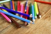 Colorful pencil arrangement casual on wooden desk — Stock Photo
