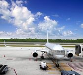 Aircraft airplane plane landed airport blue sky — Stock Photo