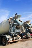 Concrete mixer two trucks rear view grunge — Stock Photo