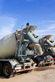 Concrete mixer two trucks rear view grunge — Stock Photo