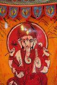 Indian elephant symbol on orange textile sheet — Stock Photo