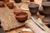 Clay pottery potter handcrafts on vintage table — Stock Photo