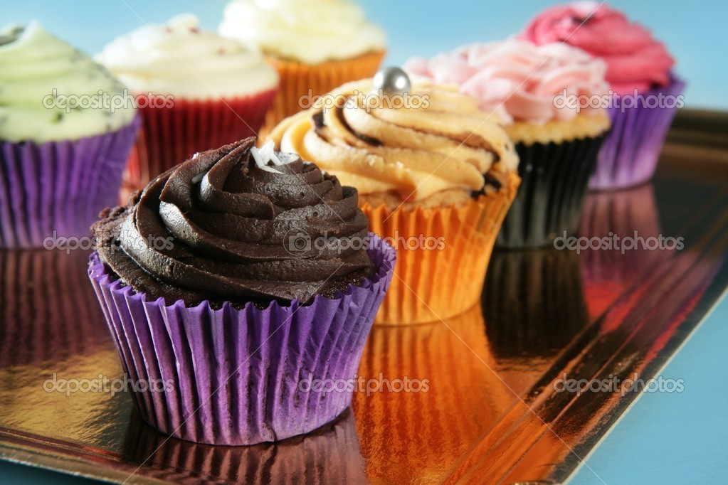 Cupcakes colorful cream muffin arrangement in golden mirror tray  Stockfoto #5567427