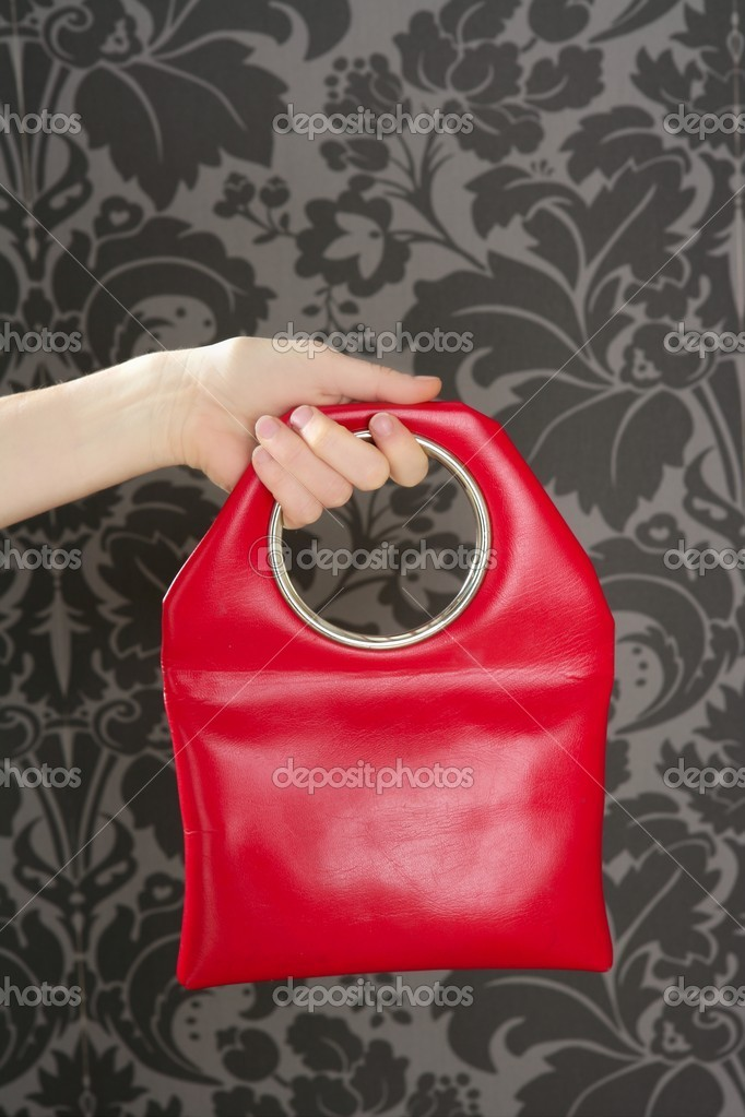 Handbag retro vintage fashion red bag on gray wallpaper sixties — Stock Photo #5568989