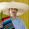 Chili hot pepper Mexican man typical poncho serape — Stock Photo #5600187