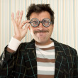 Nerd silly crazy myopic glasses man funny gesture - Stock Photo