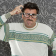 Nerd pensive silly man retro wallpaper glasses tacky — Stock Photo #5600328