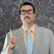 Nerd retro businessman raising finger up hand gesture - Stock Photo