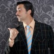 Nerd businessman portrait pointing thumb finger - Stock Photo