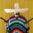 Bandit Mexican revolver mustache gunman sombrero - Stock Photo